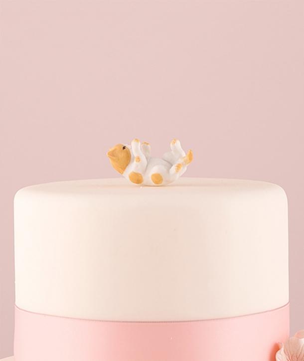 Figura de gatito blanco y naranja