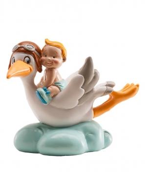 Cigüeña volando bautizo niño
